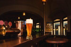 Glass of lager beer on bar of restaurant